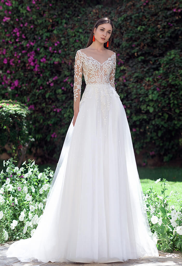 f9a83bd534e0 Berømte Brudekjole med lange blonde ærmer